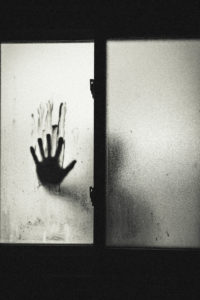 hand against glass