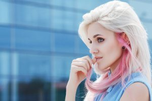 woman with blonde and pink hair thinking