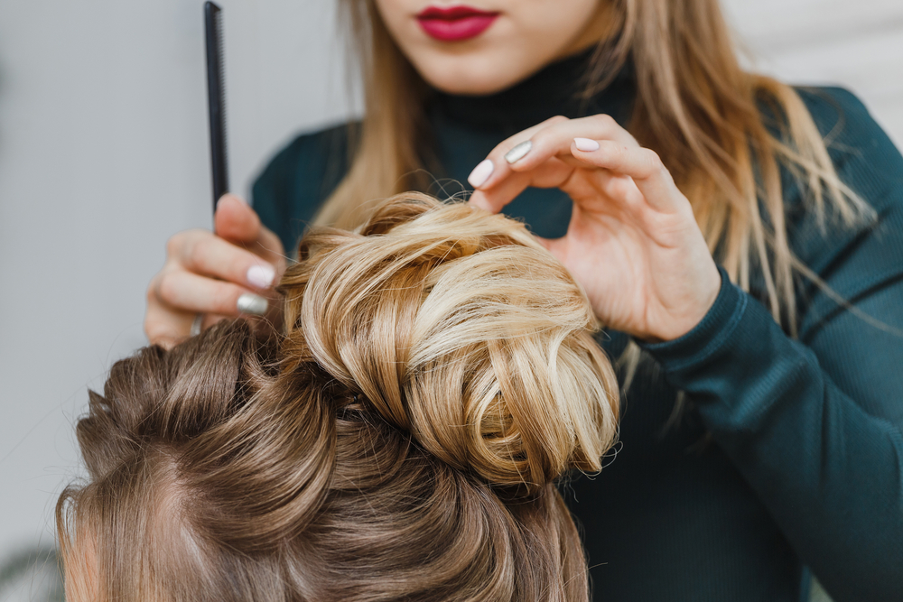 stylist helping someone with their hair