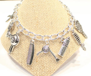 Silver charm bracelet with hair charms brush comb hair spray hair dryer