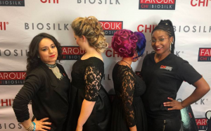 CHI School Showcase Winners four woman wearing black with fancy hairstyles