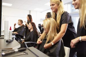 Group of cosmetology students and customers in a slaon