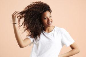A beautiful African American woman showcasing beautiful hair and skin