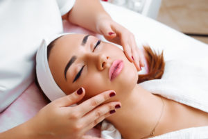 esthetics Client getting a facial